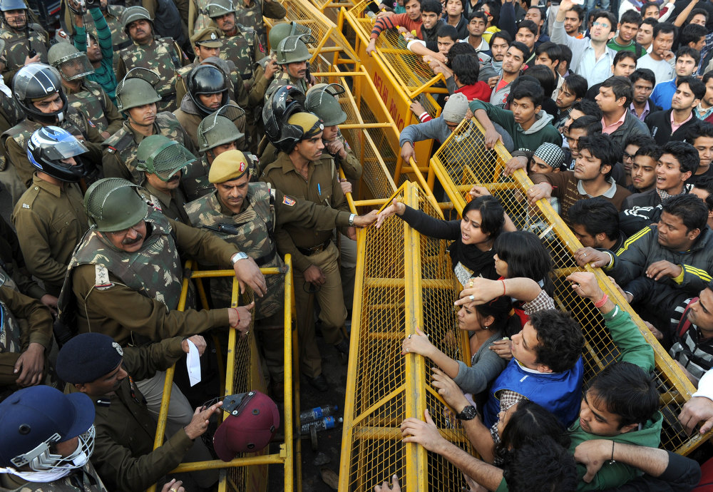 . Indian demonstrators push against a police barricade during a protest calling for  better safety for women following the rape of a student last week, in front of the Government Secretariat and Presidential Palace in New Delhi on December 22, 2012. Indian police on December 22 baton-charged, tear-gassed and fired water cannon at demonstrators who were demanding better safety for women following the brutal gang-rape of a student last weekend. Thousands of protesters, who rallied at the India Gate monument in the heart of the Indian capital and surged toward the president\'s palace, were calling for stepped-up security for women across the country. SAJJAD HUSSAIN/AFP/Getty Images