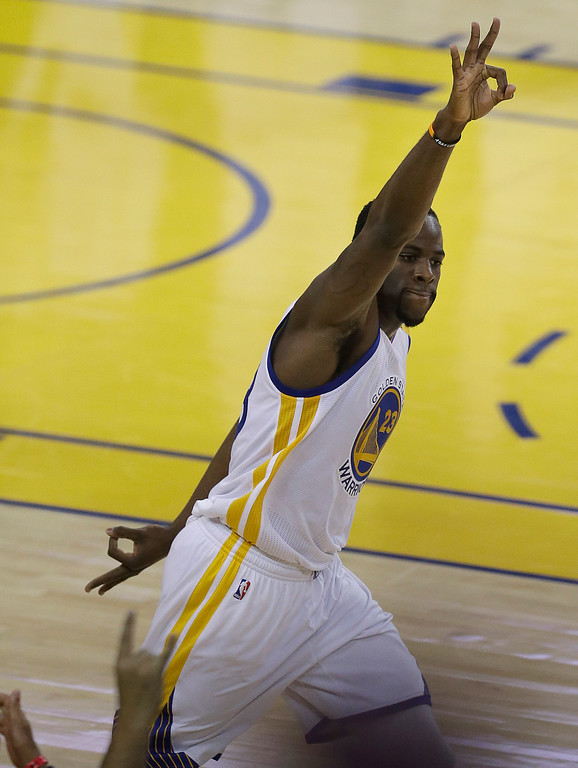 . Golden State Warriors forward Draymond Green (23) gestures after scoring against the Cleveland Cavaliers during the first half of Game 5 of basketball\'s NBA Finals in Oakland, Calif., Monday, June 12, 2017. (AP Photo/Ben Margot)