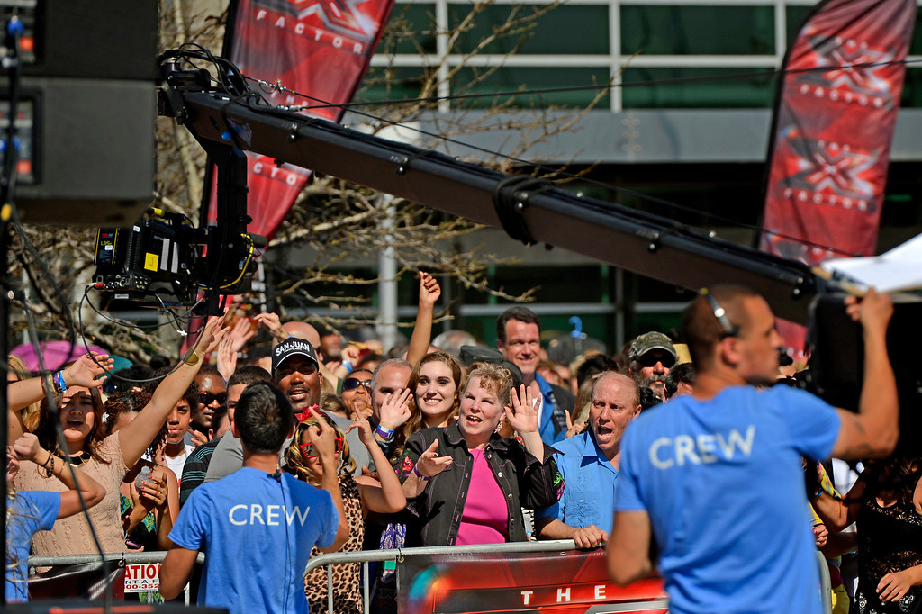 ". The crowd dancing for the cameras before going inside to take their chances on Fox\'s ""X-Factor\"" reality TV singing competition at the Denver Coliseum May 14, 2013 Denver, Colorado. (Photo By Joe Amon/The Denver Post)"