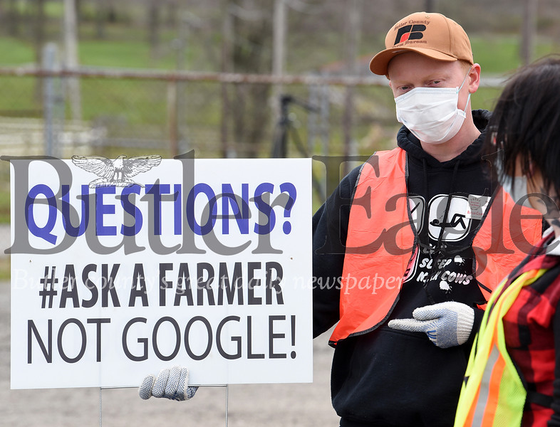 Harold Aughton/Butler Eagle: Dairy farmer William Thiele of Cabot volunteered to distribute food during the The Greater Pittsburgh Community Food Bank food distribution event at the Big Butler Fairgrounds on Tuesday, April 28, 2020.