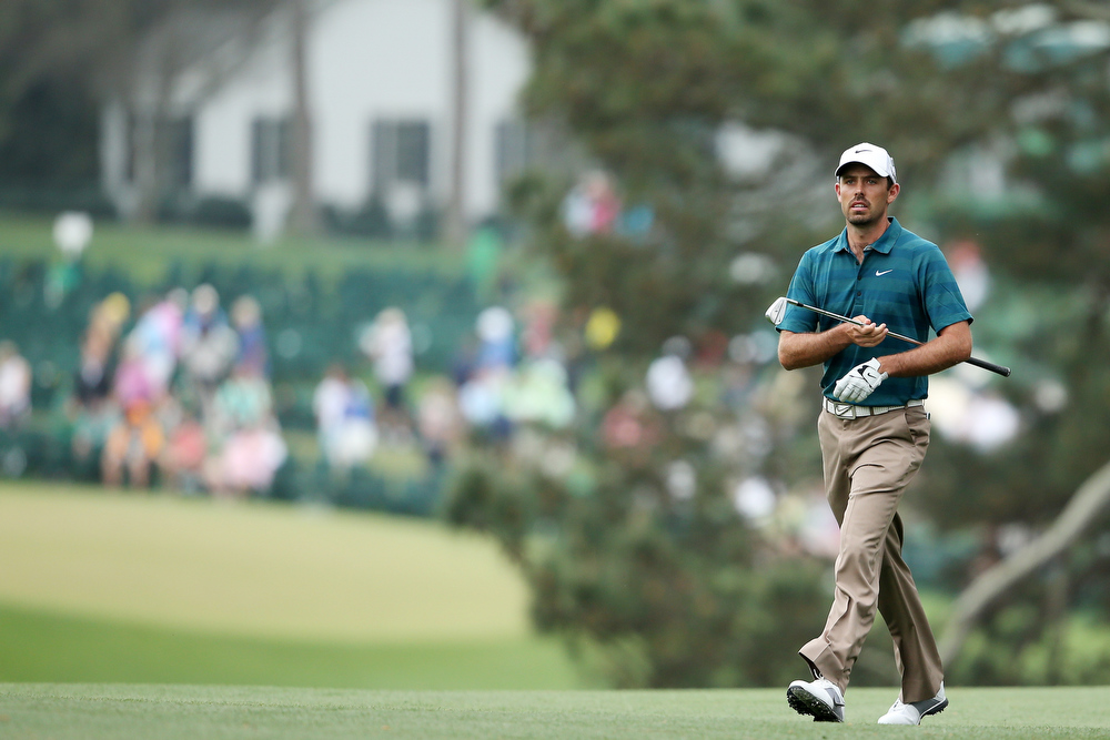 Description of . Charl Schwartzel of South Africa walks towards the green on from the first hole during the first round of the 2013 Masters Tournament at Augusta National Golf Club on April 11, 2013 in Augusta, Georgia.  (Photo by Andrew Redington/Getty Images)