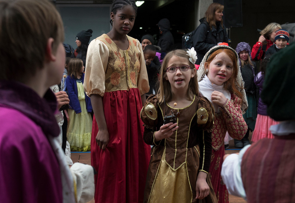. Bintou Diane, 11, left, Payden Coffey, 8, and Chloe McPhee, 10, right, perform The Comedy of Errors with fellow classmates from Lowry Elementary School.  (Photo by Kathryn Scott Osler/The Denver Post)
