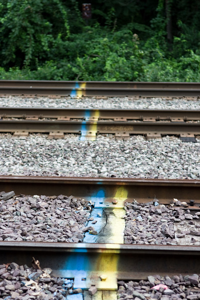 Paint marks on the train tracks.