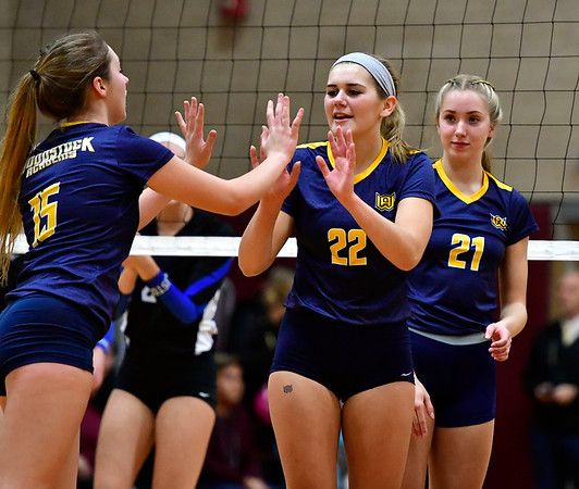 11/14/2018 Mike Orazzi | Staff Woodstock Academy's Samantha Orlowski (15), Natalie Low (22) and Amelia Large (21) during the Class L Semifinal State Girls Volleyball Tournament held at Windsor High School Wednesday night.