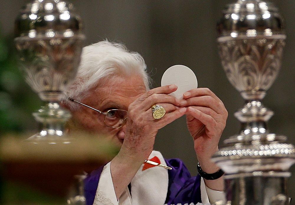". Pope Benedict XVI holds up the host as he celebrates the Ash Wednesday mass in St. Peter\'s Basilica at the Vatican, Wednesday, Feb. 13, 2013.  Ash Wednesday marks the beginning of Lent, a solemn period of 40 days of prayer and self-denial leading up to Easter. Pope Benedict XVI told thousands of faithful Wednesday that he was resigning for ""the good of the church\"", an extraordinary scene of a pope explaining himself to his flock that unfolded in his first appearance since dropping the bombshell announcement. (AP Photo/Gregorio Borgia)"