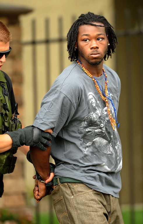 . Robert Eugene Coleman, 21, of San Bernardino was taken into custody in connection with the shooting around 3 p.m. by sheriff\'s deputies after a search on land and by air, authorities said. He was booked into Central Detention Center in San Bernardino.(LaFonzo Carter/ Staff Photographer