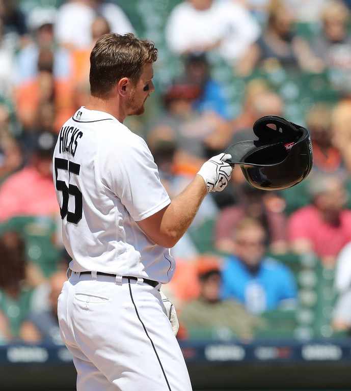 . Detroit Tigers\' John Hicks tosses his helmet after striking out during the seventh inning of a baseball game against the Cleveland Indians, Wednesday, May 16, 2018, in Detroit. (AP Photo/Carlos Osorio)