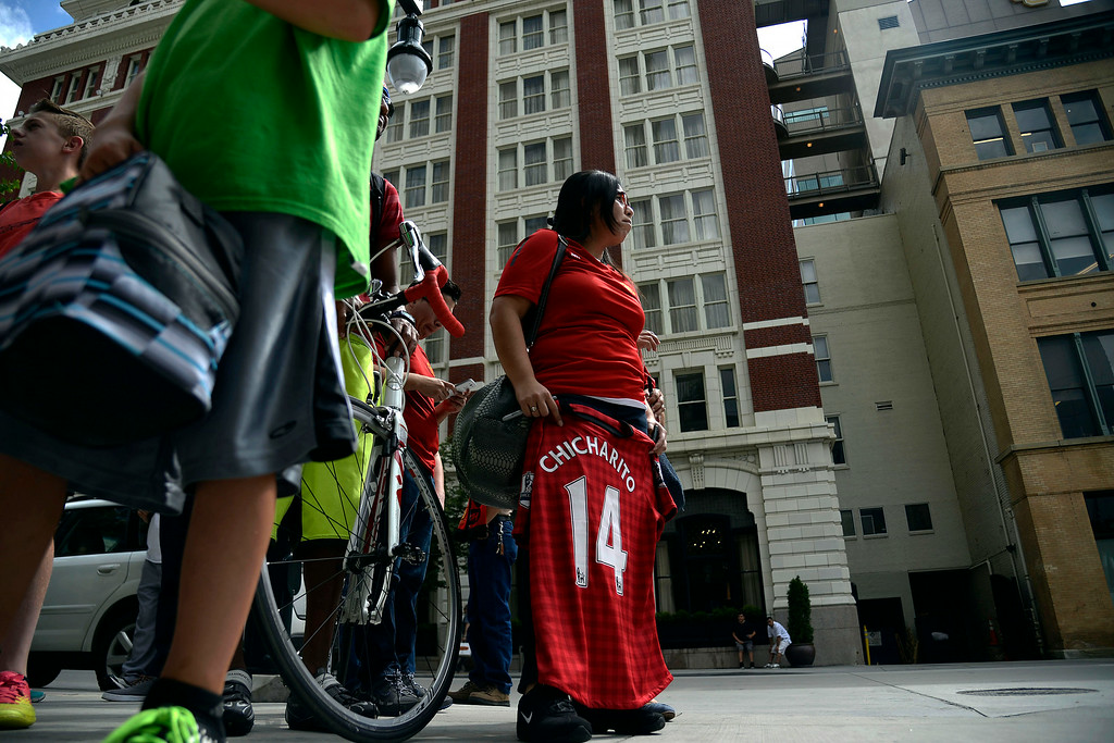 . DENVER, CO - JULY 24: Yajaira Fuentes-Tauber holds Javier Chicarito Hernandez jersey in hand as she waits with fellow fans for the Manchester United soccer team to arrive at their hotel. Manchester United will play Italian squad Roma on Saturday, July 26 and arrived in Denver on Thursday, July 24, 2014. (Photo by AAron Ontiveroz/The Denver Post)