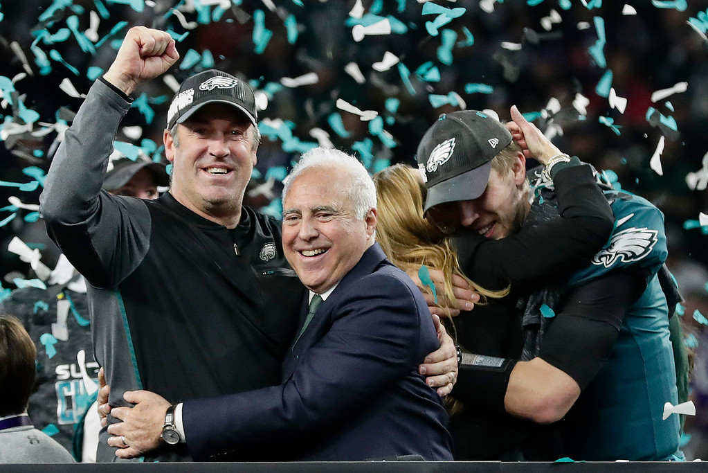 . Philadelphia Eagles head coach Doug Pederson, left, hugs owner Jeffrey Lurie as they celebrate after beating the New England Patriots in the NFL Super Bowl 52 football game Sunday, Feb. 4, 2018, in Minneapolis. (AP Photo/Frank Franklin II)