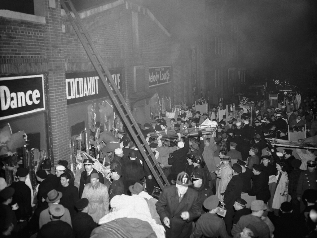 . Boston City firefighters and policemen and emergency service workers jam the street outside the Cocoanut Grove Night Club during sudden fire that swept the club before  patrons had a chance to escape, Nov. 28, 1942. (AP Photo)