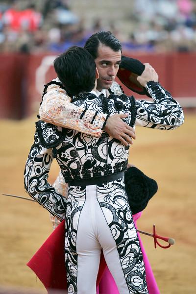 The bullfighters Uceda Leal and Fernando Cruz (backwards) hug. Bullfight at Real Maestranza bullring, Seville, Spain, 15 August 2006.