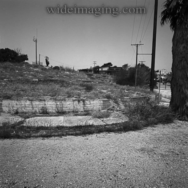 Playa Del Rey, Ghost Town: Trask Avenue and Napoleon Street, with the background surviving homes on Waterview Street in contrast. The property retaining wall remains by a sidewalk that has not been walked on in 40 years.