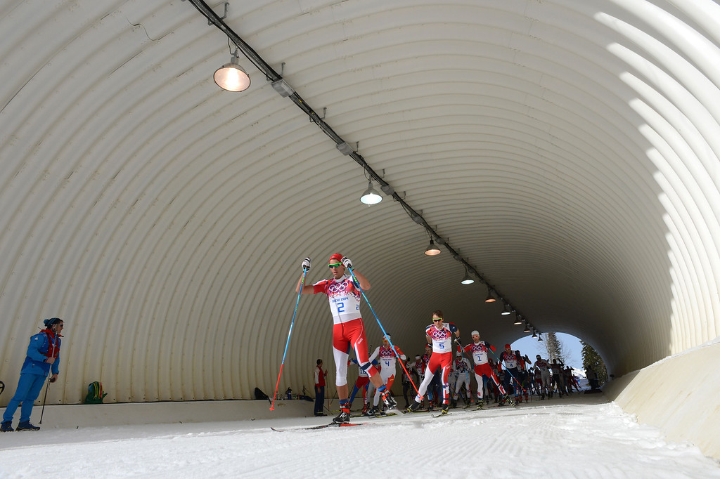 . Norway\'s Chris Andre Jespersen (2), Canada\'s Alex Harvey (4), Norway\'s Petter Jr Northug (5) and Norway\'s Martin Johnsrud Sundby (1) compete in the Men\'s Cross-Country Skiing 50km Mass Start Free at the Laura Cross-Country Ski and Biathlon Center during the Sochi Winter Olympics on February 23, 2014, in Rosa Khutor, near Sochi.     AFP PHOTO / KIRILL KUDRYAVTSEVKIRILL KUDRYAVTSEV/AFP/Getty Images