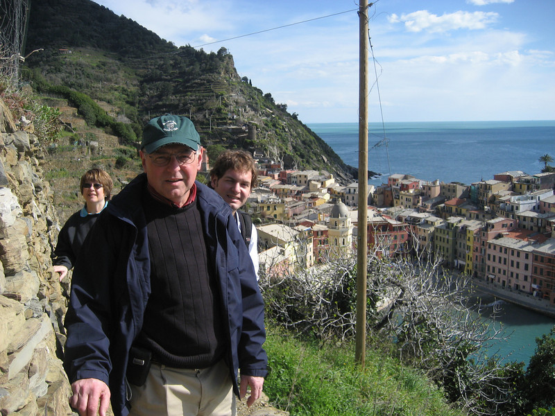 Pat, Stan and Jon Deutsch hiking in Cinque Terre with Vernazza in the background.