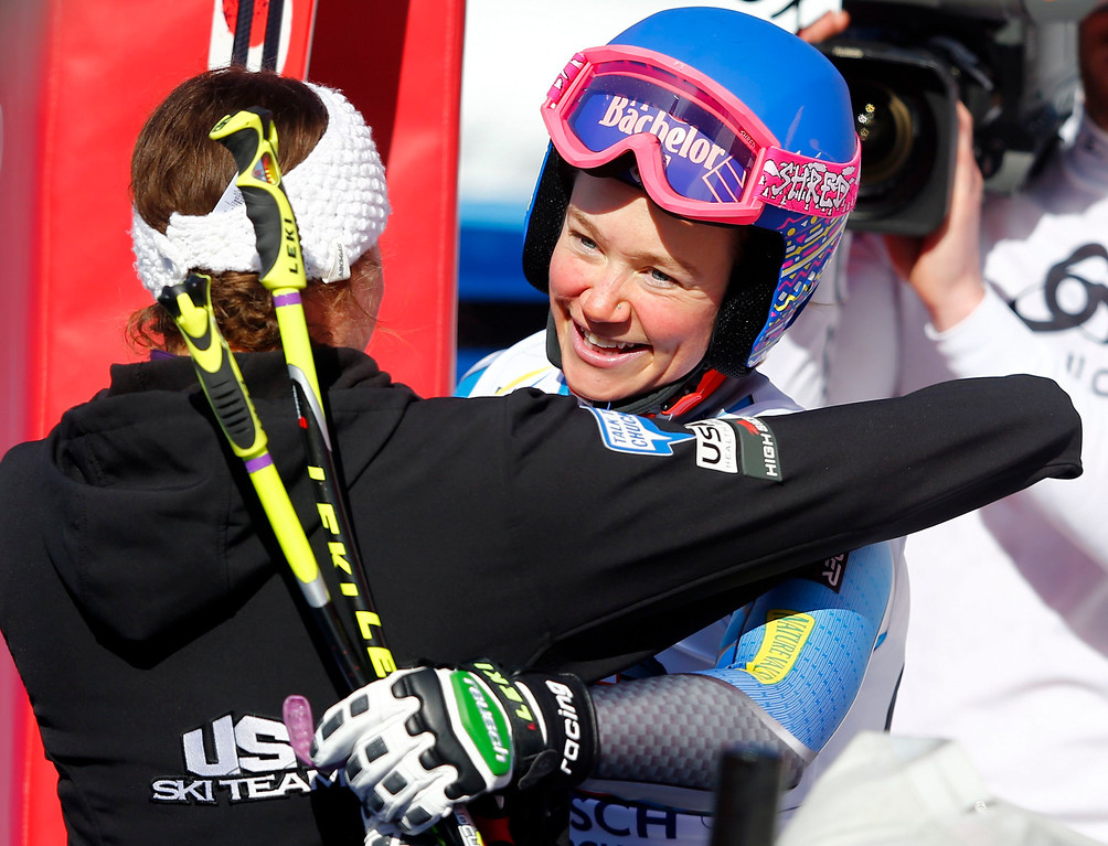 . Laurenne Ross of the U.S. (R) celebrates after the women\'s Alpine Skiing World Cup Downhill race in Garmisch-Partenkirchen March 2, 2013.  REUTERS/Michael Dalder