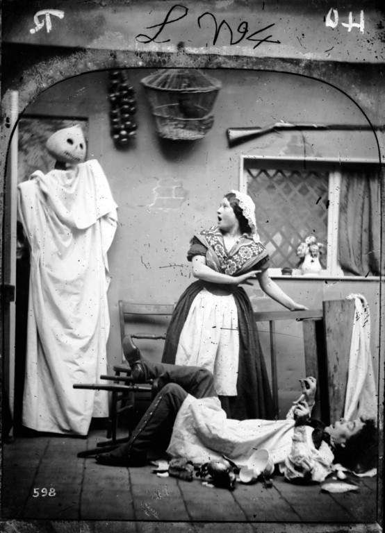 . circa 1865:  A white caped figure wearing a haloween pumpkin mask taking two people by surprise in their kitchen.  London Stereoscopic Company Comic Series - 598  (Photo by London Stereoscopic Company/Getty Images)