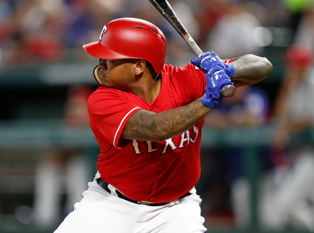 . Texas Rangers\' Willie Calhoun prepares to bat against the Cleveland Indians during the sixth inning of a baseball game, Friday, July 20, 2018, in Arlington, Texas. (AP Photo/Jim Cowsert)