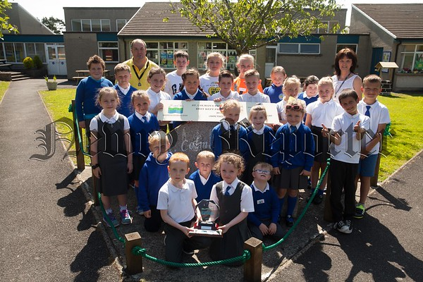 St Colman's PS Kilkeel has been awarded the best kept primary school in the Southern Region by the Northern Ireland Amenity Council. Pictured with some of the pupils are Principal Mary Donnelly and Barney McCartan. R1725060