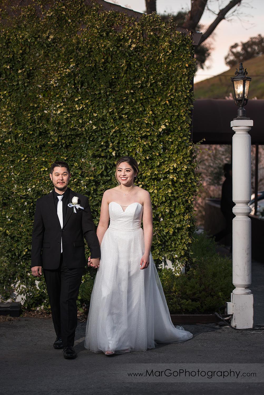bride and groom walking at Mt Hamilton GrandView Restaurant in San Jose