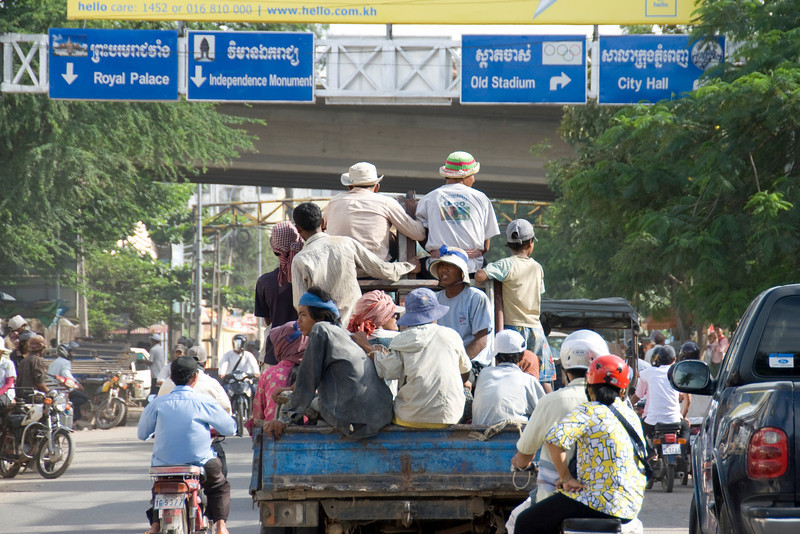 Guys loaded at the back of a truck in Phnom Penh, Cambodia