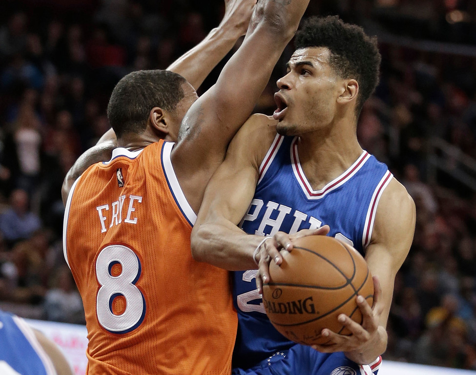 . Philadelphia 76ers\' Timothe Luwawu-Cabarrot, right, from France, drives to the basket against Cleveland Cavaliers\' Channing Frye in the second half of an NBA basketball game, Friday, March 31, 2017, in Cleveland. (AP Photo/Tony Dejak)