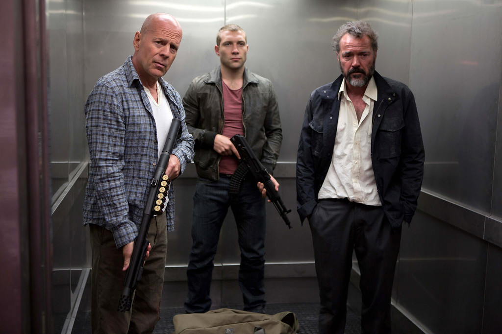 """. FILE - This publicity film image released by 20th Century Fox shows Bruce Willis as John McClane, left, Jai Courtney as his son Jack, center and Sebastian Koch as Komarov in a scene from \""""A Good Day to Die Hard.\"""" (AP Photo/20th Century Fox, Frank Masi, File)  (Movie released on January 31, 2013)"""