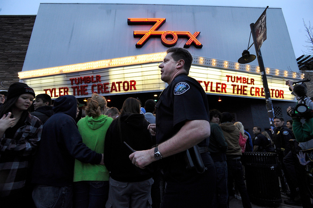 . A Boulder Police officer monitors the crowd during a disturbance at the Fox Theater on Monday, March 11, in Boulder. Boulder Police responded with riot gear to keep the fans of the band Tyler the Creator under control.  Jeremy Papasso/Boulder Daily Camera