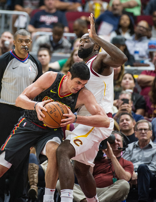 . Atlanta Hawks\' Ersan Ilyasova, left, drives past Cleveland Cavaliers\' Kendrick Perkins during the second half of an NBA pre-season basketball game in Cleveland, Wednesday, Oct. 4, 2017. The Hawks won 109-93. (AP Photo/Phil Long)