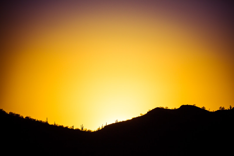 The Sun Setting Behind a Mountain