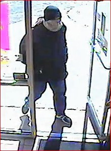 Police are looking for the masked man who robbed three stores at gunpoint last week.