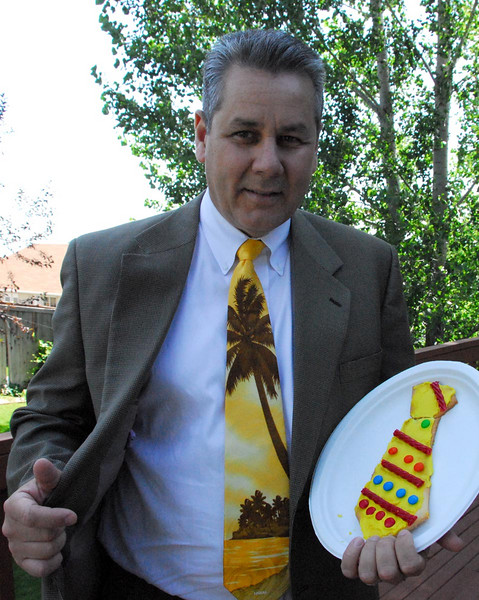 6/17/07 – It was Father's Day so I was showing off my ties. The one I'm wearing Jessica sent me from Hawaii. The one I'm about to eat is a cookie some of the young women made and delivered to the fathers in our ward.