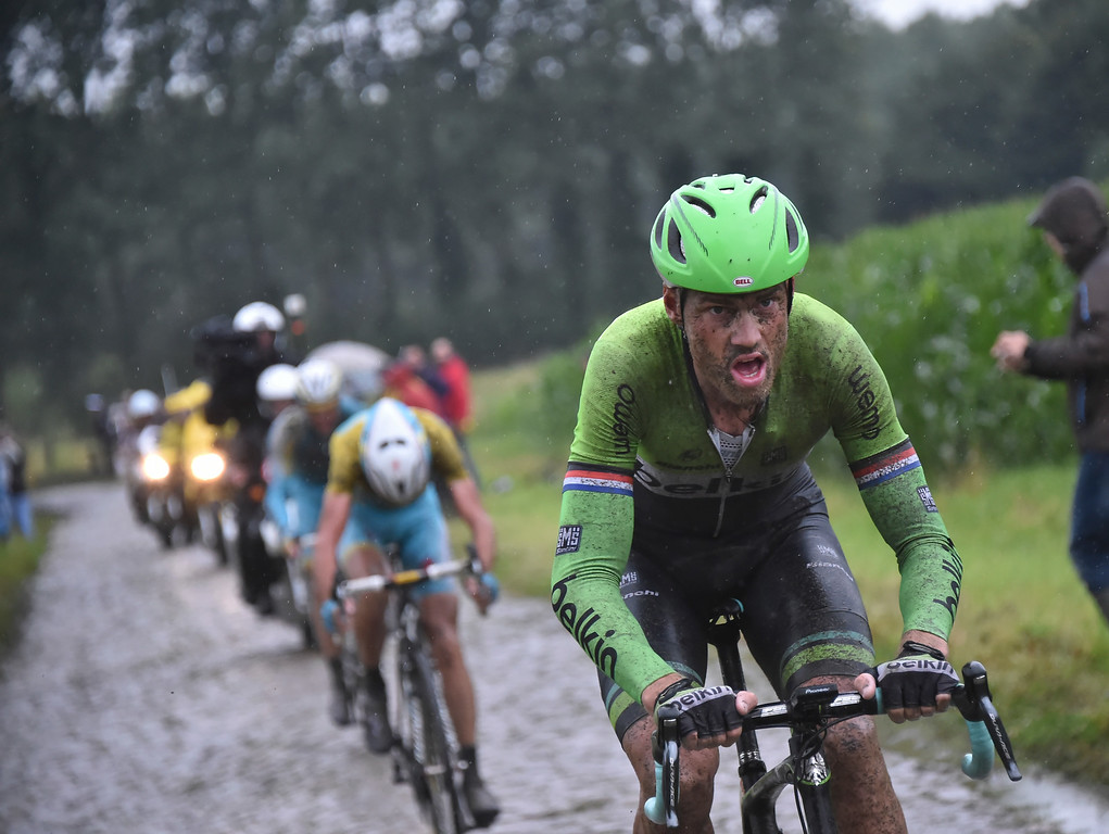 . Stage winner Lars Boom of The Netherlands, front, grimaces as he breaks away from overall leader Italy\'s Vincenzo Nibali, rear, during the fifth stage of the Tour de France cycling race over 155 kilometers (96.3 miles) with start in Ypres, Belgium, and finish in Arenberg, France, Wednesday, July 9, 2014. (AP Photo/Bernard Papon, Pool)