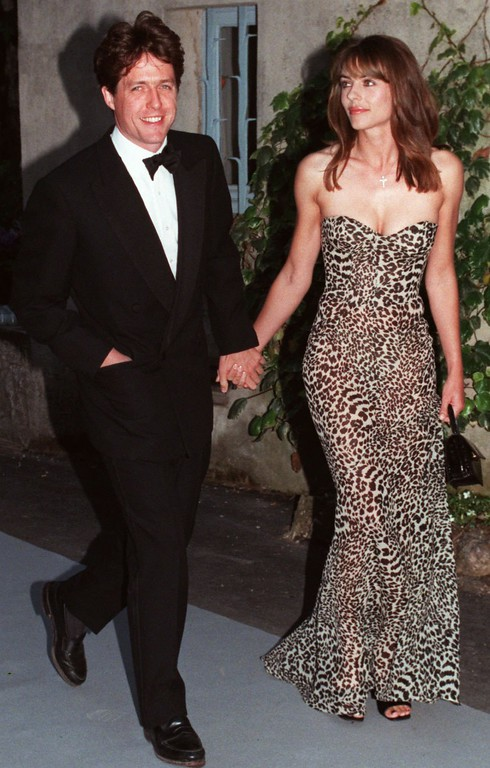 . Movie star Hugh Grant and actress Liz Hurley arrive at the Moulins de Mougins world known restaurant  near Cannes on Thursday May 15, 1997  to attend the AmFAR (American Foundation for AIDS Research) dinner. Since 1985 AmFAR has awarded grants in excess of USD 83 million to more than 1700 reaseach teans internationally.(AP photo/Remy de la Mauviniere/Pool)