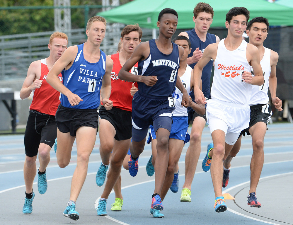 . Mayfair\'s Ellis Newton competes in the division 2 1600 meter run during the CIF Southern Section track and final Championships at Cerritos College in Norwalk, Calif., on Saturday, May 24, 2014.   (Keith Birmingham/Pasadena Star-News)