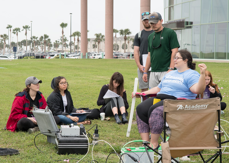 Ph.D. student Aubrey Douglas explains how to measure the level of water in a well during an Environmental Geology lab held in front of the Performing Arts Center.