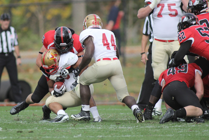 Tanner Burch (55) fights VMI for a tackle
