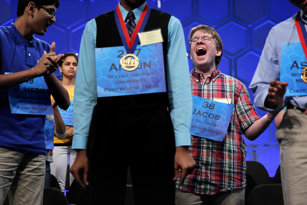 . Speller Jacob Daniel Williamson (R) of Cape Coral, Florida, celebrates as he learns through announcement that he has advanced to the final rounds of the 2014 Scripps National Spelling Bee competition May 29, 2014 in National Harbor, Maryland. Twelve spellers have advanced to the finals to compete for the top honor in the annual spelling contest.  (Photo by Alex Wong/Getty Images)