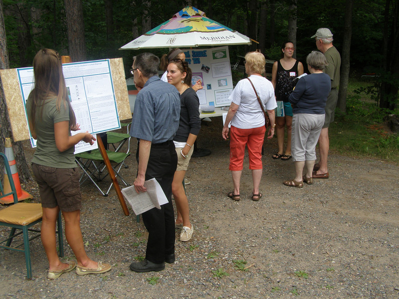 Throughout the afternoon, students and faculty stayed busy talking with visitors about their work. Here, students explain the displays for an invasive species air-drying experiment and boater survey research.
