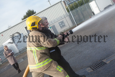 Newry Reporter journalist Ryan Sands is pictured with Firefighter Barry Duffy. R1609007