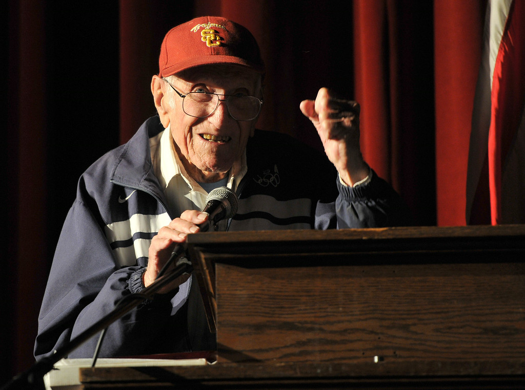. Torrance legend Louis Zamperini paid a visit to his alma mater Torrance High to visit with alumni and meet students. Zamperini pumps his fist to acknowledge cheers from students.   (3/31/11) (Photo by Robert Casillas/Daily Breeze)
