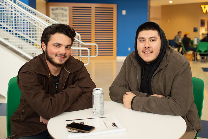 Students Ed Klash (left), and Ivan Zubeldia hang out in the University Center Rotunda on the first day of the Spring 2019 Semester.