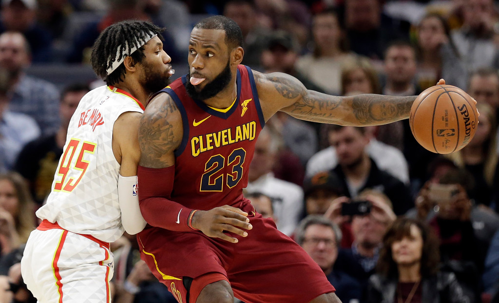 . Cleveland Cavaliers\' LeBron James (23) drives against Atlanta Hawks\' DeAndre\' Bembry (95) in the first half of an NBA basketball game, Tuesday, Dec. 12, 2017, in Cleveland. (AP Photo/Tony Dejak)
