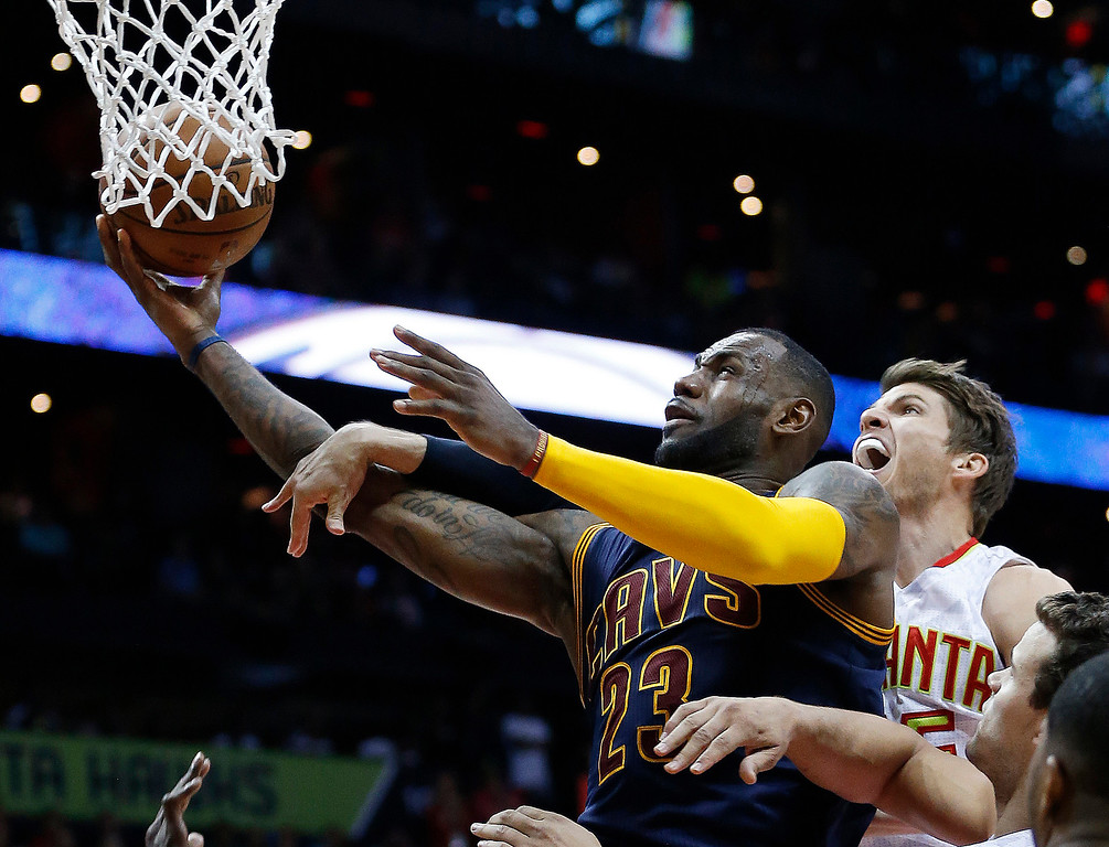 . Cleveland Cavaliers forward LeBron James (23) heads to the hoop against Atlanta Hawks guard Kyle Korver (26) in the second half  of Game 4 of the second-round NBA basketball playoff series, Sunday, May 8, 2016, in Atlanta. (AP Photo/John Bazemore)