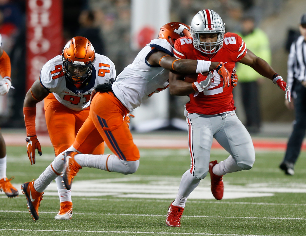 . Illinois defensive back Stanley Green, center, tackles Ohio State running back J.K. Dobbins during the first half of an NCAA college football game Saturday, Nov. 18, 2017, in Columbus, Ohio. (AP Photo/Jay LaPrete)