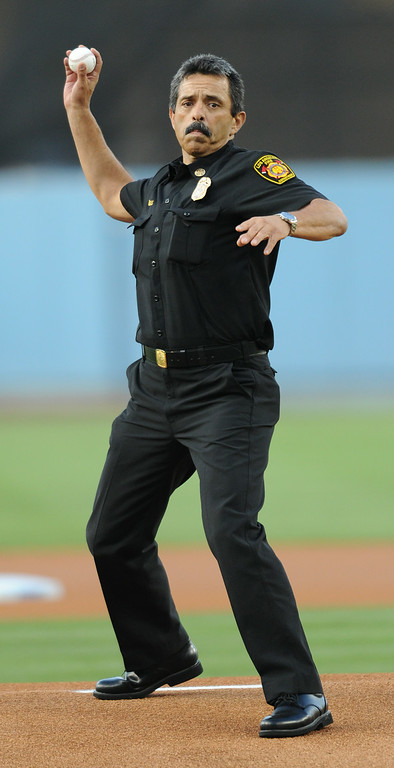 . Newly installed LAFD Chief Ralph Terrazas throws out the first pitch at Dodger Stadium, as the team hosts the San Diego Padres at the inaugural Firefighter Appreciation Night. Los Angeles, CA. 8/19/2014(Photo by John McCoy Daily News)