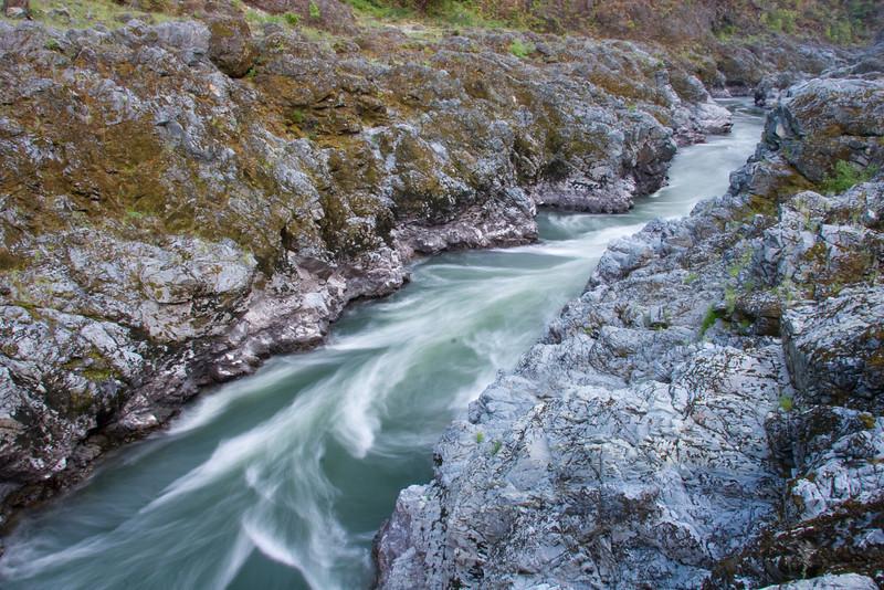 Coffeepot Rapid swirls through the convoluted walls of Mule Creek Canyon.
