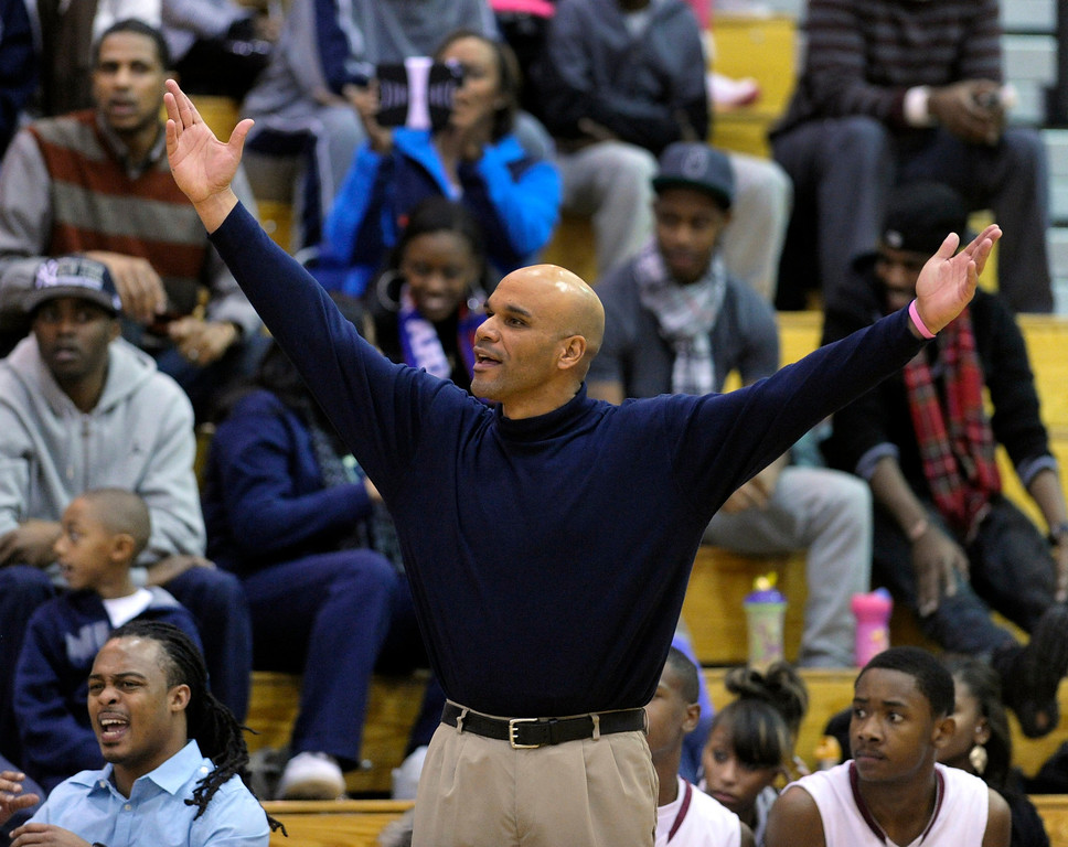 . Cougars coach Morgan Gregory reacted to a call in the second half. The Cherokee Trail boy\'s basketball team defeated Overland 59-57 Friday night, January 11, 2013. Karl Gehring/The Denver Post