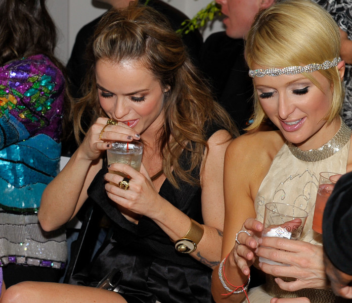 "Photograph of Paris Hilton dressed as flapper attending Oscar Party with IS VODKA www.ISVodka.com and  fashion show featuring  Russel Simmons new clothes line ""Argyle Culture."""
