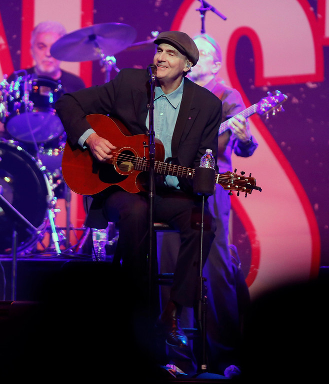 . James Taylor performs at the Boston Strong Concert: An Evening of Support and Celebration at the TD Garden on Thursday, May 30, 2013 in Boston. (Photo by Bizuayehu Tesfaye/Invision/AP)