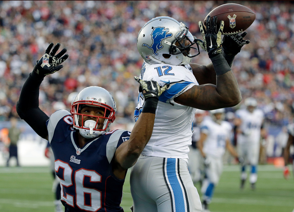 . Detroit Lions wide receiver Jeremy Ross (12) tries to catch a pass in front of New England Patriots cornerback Logan Ryan (26) in the second half of an NFL football game Sunday, Nov. 23, 2014, in Foxborough, Mass. The pass was incomplete. (AP Photo/Stephan Savoia)